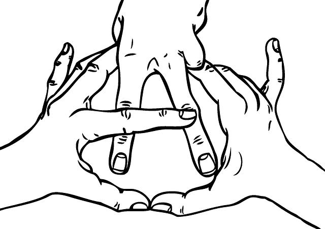 Ruky, prsty tvoriace symbol anarchie